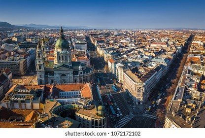 Budapest, Hungary - Aerial view of St.Stephen's basilica with Andrassy street and Bajcsy-Zsilinszky street at sunset with clear blue sky