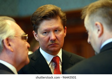 BUDAPEST, HUNGARY - APRIL 1: OAO Gazprom Chief Executive Alexei Miller, center, speaks to Mol Rt. Chief Executive Zsolt Hernadi, right, in the Hungarian Parliament on April 1, 2005 in Budapest, Hungary,