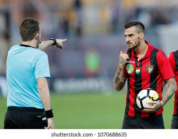 BUDAPEST, HUNGARY - APRIL 11, 2018: Davide Lanzafame of Budapest Honved (r) disputes with the linesman during Budapest Honved v Videoton FC match at Bozsik Stadium.
