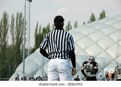 BUDAPEST, HUNGARY - APRIL 11: An umpire in action at Hungarian American Footbal match between Ujpest Bulldogs vs. Dunaujvaros Gorillaz 11 April, 2009 in Budapest, Hungary. Bulldogs beat Gorillaz 34–0.