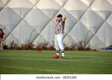 BUDAPEST, HUNGARY - APRIL 11: An umpire in action at Hungarian American Footbal match between Ujpest Bulldogs vs. Dunaujvaros Gorillaz 11 April, 2009 in Budapest, Hungary. Gorillaz beat Bulldogs 34-0.