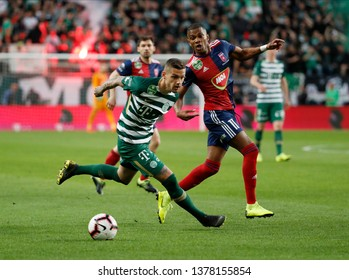 BUDAPEST, HUNGARY - APRIL 20, 2019: (l-r) Marcel Heister competes for the ball with Loic Nego during Ferencvarosi TC v MOL Vidi FC OTP Bank Liga match at Groupama Arena.
