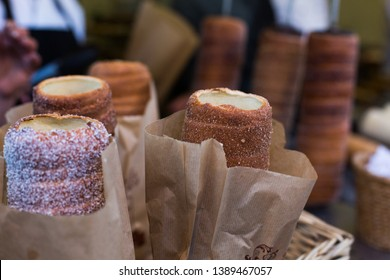 Budapest - Hungary - April 20, 2019: Trdelnik,Trdlo or Kurtosh Kalach baked in a street bakery in Budapest