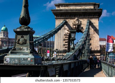 BUDAPEST, HUNGARY - APRIL, 2018: The historical Szechenyi Chain Bridge a suspension bridge that spans the River Danube between Buda and Pest first opened in 1849
