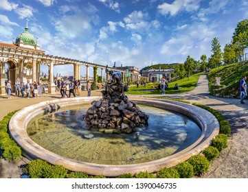 Budapest, Hungary - April 22, 2019,:The inner park with visitors of the Castle Garden Bazaar (Varkert Bazar) designed by Miklos Ybl .