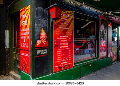 BUDAPEST HUNGARY APRIL 26 2018: Street art advertisement of a restaurant - now making fun out of the once hard line communist system.