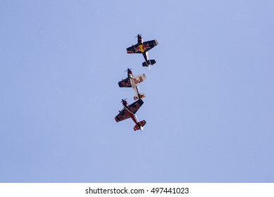 Budapest, Hungary - April 30, 2016. A group of Corvus Racer 540 Red Bull Air Race aircrafts flies in close formation over the river Danube, during an air show at the city of Budapest.