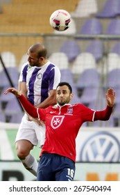 BUDAPEST, HUNGARY - APRIL 5, 2015: Air battle between Jonathan Heris of Ujpest (l) and Filipe Oliveira of Videoton during Ujpest vs. Videoton OTP Bank League football match in Ferenc Szusza Stadium.