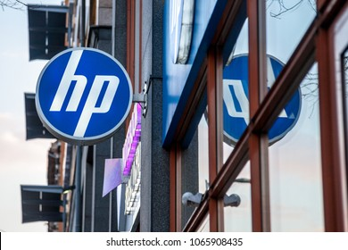 BUDAPEST, HUNGARY - APRIL 6, 2018: HP logo on their main shop for Hungary during the evening. Hewlett Packard is one of the main computer manufacturers in the world