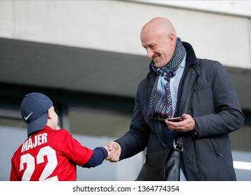 BUDAPEST, HUNGARY - APRIL 6, 2019: (l-r) A young supporter shake hands with head coach Marco Rossi of Hungarian national team prior to Honved v MOL Vidi FC OTP Bank Liga match at Hidegkuti Stadium.