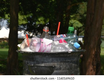 Budapest Hungary. Aug 17 2018. A piled up garbage bin filled to the top, about to overflow, with single use plastic waste (including solid waste plastic bottles, cups, straws) in a Budapest park