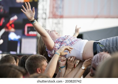 Budapest, Hungary - August 10th 2010: A young adult female crowd surfing at the Sziget Festival