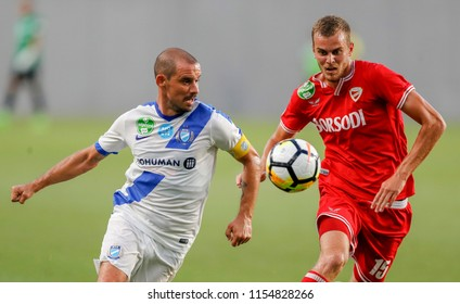BUDAPEST, HUNGARY - AUGUST 11, 2018: (l-r) Jozsef Kanta competes for the ball with Barnabas Toth during MTK Budapest v DVTK match at Nandor Hidegkuti Stadium.
