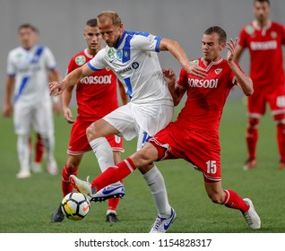 BUDAPEST, HUNGARY - AUGUST 11, 2018: (r-l) Barnabas Toth fights for the ball with Sandor Torghelle in front of Matyas Tajti during MTK Budapest v DVTK match at Nandor Hidegkuti Stadium.