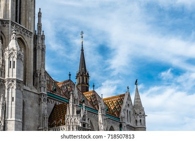 Budapest, Hungary - August 12, 2017: Detail of roof of Matthias Church. It is a Roman Catholic church located in front of the Fisherman's Bastion at the heart of Buda's Castle District.