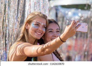 BUDAPEST, HUNGARY - AUGUST 15, 2017 : Unknown girls is a participants of cultural and music festival Sziget. Beautiful girls doing selfie on phone at Sziget Festival