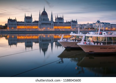 Budapest, Hungary - August 16, 2018: View of Hungarian Parliament over river Danube early in the morning.