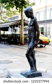 Budapest, HUNGARY - AUGUST 17, 2018:   Váci utca (Váci street). Created in 1976 by Ottó Szenczi, known as the Little boy fountain and features a central statue of a nude boy.