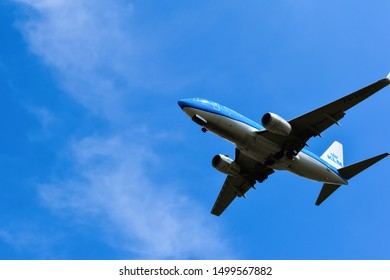 Budapest, Hungary - August 17, 2019: Flying KLM Royal Dutch Airlines passenger airplane from below in the blue sky, during landing.