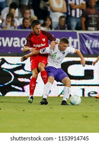 BUDAPEST, HUNGARY - AUGUST 2, 2018: (l-r) Pablo Sarabia competes for the ball with Donat Zsoter during Ujpest FC v Sevilla FC UEFA EL match at Ferenc Szusza Stadium.