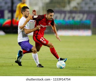 BUDAPEST, HUNGARY - AUGUST 2, 2018: (l-r) Bojan Sankovic competes for the ball with Pablo Sarabia during Ujpest FC v Sevilla FC UEFA EL match at Ferenc Szusza Stadium.