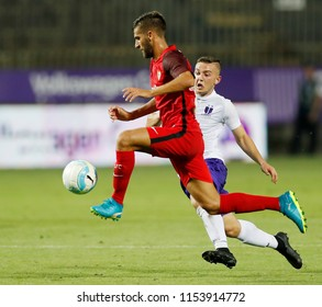 BUDAPEST, HUNGARY - AUGUST 2, 2018: (l-r) Pejino competes for the ball with Donat Zsoter during Ujpest FC v Sevilla FC UEFA EL match at Ferenc Szusza Stadium.
