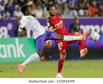 BUDAPEST, HUNGARY - AUGUST 2, 2018: (l-r) Alassane Diallo competes for the ball with Franco Vazquez during Ujpest FC v Sevilla FC UEFA EL match at Ferenc Szusza Stadium.