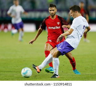 BUDAPEST, HUNGARY - AUGUST 2, 2018: (l-r)  Gabriel Mercado competes for the ball with Benjamin Balazs during Ujpest FC v Sevilla FC UEFA EL match at Ferenc Szusza Stadium.