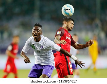 BUDAPEST, HUNGARY - AUGUST 2, 2018: (l-r) Obinna Nwobodo competes for the ball with Ever Banega during Ujpest FC v Sevilla FC UEFA EL match at Ferenc Szusza Stadium.