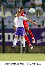 BUDAPEST, HUNGARY - AUGUST 2, 2018: (l-r) Donat Zsoter battles for the ball in the air with Daniel Carrico during Ujpest FC v Sevilla FC UEFA EL match at Ferenc Szusza Stadium.