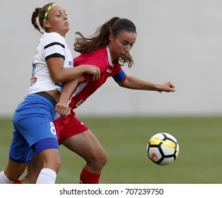 BUDAPEST, HUNGARY - AUGUST 22, 2017: Barbara Toth #8 of MTK fights for the ball with Zelfie Bajramaj (R) of Hajvalia during MTK Hungaria FC v WFC Hajvalia UEFA Women's CL match at Hidegkuti Stadium.
