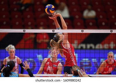 BUDAPEST, HUNGARY – August 23, 2019: Bernarda Brcic (15) posts the ball, at the Croatia(red) – Azerbaijan (blue) 2019 CEV Volleyball European Championship's women volleyball game.