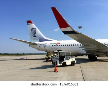 BUDAPEST, HUNGARY - AUGUST 28, 2019: Norwegian airplanes are known for their white livery with a red nose and a portrait on its tail.  Portrait of Swedish artist Anders Zorn on a Boeing 737-800.
