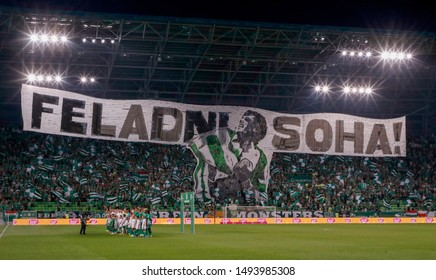 BUDAPEST, HUNGARY - AUGUST 29, 2019: Ultras lift up a banner with text 'Never give up!' prior to Ferencvarosi TC v FK Suduva UEFA EL match at Ferencvaros Stadium.