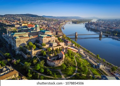 Budapest, Hungary - Beautiful aerial skyline view of Buda Castle Royal Palace and South Rondella at sunset with Szechenyi Chain Bridge over River Danube, Matthias Church and Parliament of Hungary