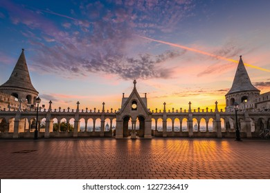 Budapest, Hungary - Beautiful golden sunrise at Fisherman's Bastion (Halaszbastya), Buda district with Parliament of Hungary and St. Stephen's Basilica at background with colourful sky and clouds