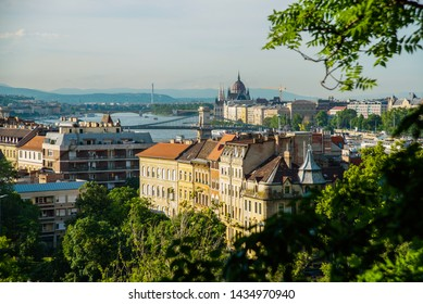 Budapest, Hungary: Beautiful landscape on the Parliament building, the chain bridge and the Danube river. View of the city from the top of Gellert hill.