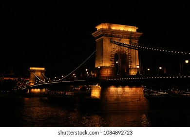 Budapest, Hungary - Beautiful Szechenyi Chain Bridge with sightseeing boat on River Danube at night with light