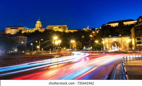 Budapest, Hungary. Car traffic trail lights with illuminated Chain bridge and Buda Castle in Budapest, Hungary at night. Clear blue sky