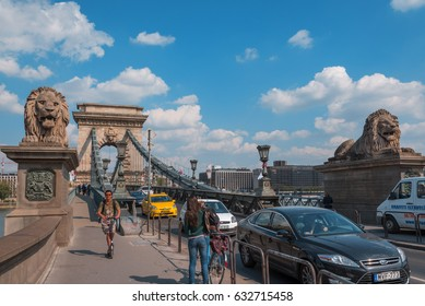 Budapest, Hungary – CIRCA April 2016: Traffic of cars and people on Chain Bridge.