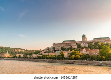 BUDAPEST, HUNGARY - CIRCA JUNE 2019: View on the famous Castle of Budapest as the sun sets circa June 2019 in Budapest, Hungary.