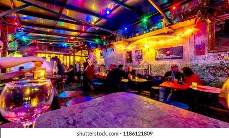 BUDAPEST, HUNGARY - CIRCA OCTOBER 2017: Interior view of the famous Szimpla Garden ruin pub as people enjoy their friends company circa October, 2017 in Budapest, Hungary.