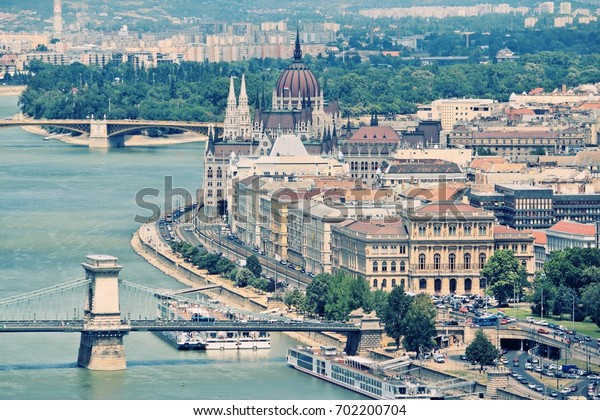 Budapest, Hungary - cityscape with Danube river, Szechenyi Chain Bridge and Parliament building. Desaturated retro colors style.