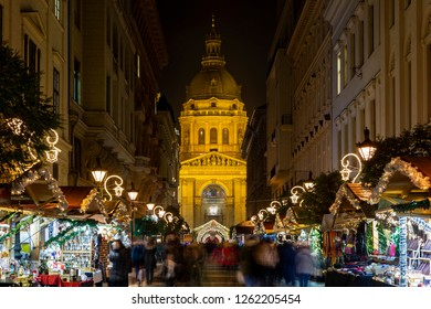 Budapest Hungary - Dec 14 2014: Tourists enjoy the Christmas lights at the St Steven Basilica in Budapest, Hungary. This traditional Christmas fair attracts abut 900,000 visitors each year.