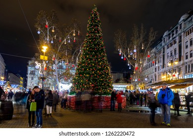 Budapest, Hungary - DEC 14 2018: Tourists enjoy the Christmas spirit and the light show in down town Budapest. This traditional Christmas fair attracts over million visitors each year.