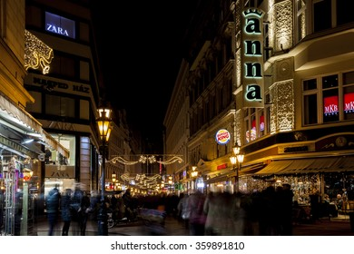 BUDAPEST, HUNGARY - DEC 19 2015: Tourists enjoy the Christmas spirit and the light show in down town Budapest. This traditional Christmas fair attracts over million visitors each year.