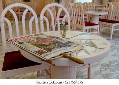 Budapest Hungary Dec 6 2018:Luxurious coffee shop with tables and chairs in the classic interior with news paper holder.