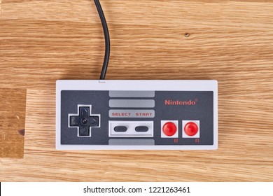 BUDAPEST, HUNGARY - DECEMBER 10, 2017: Nintendo NES classic controller on a table. One of the most classic gaming consoles