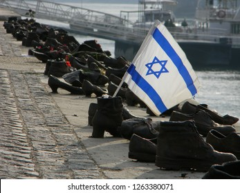 Budapest, Hungary - December 14 2018: Shoes on the Danube Bank Memorial, commemorating the death of innocent Jews shot by the Arrow Cross fascist militia during WW2.