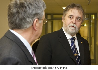 BUDAPEST, HUNGARY - DECEMBER 14: Barna Mezey, rector of the ELTE university (r) salutes Laszlo Lovasz Kioto Price awarded mathematician on December 14, 2010 in Budapest, Hungary.